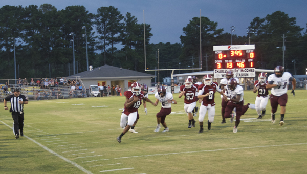 Lamont Bush breaks free down the right side line for one of his many big runs on the night. He and fellow running backs Keyvontae Mayfield and Michael Norwood led Shelby County to a 49-35 win over St. Claire County. (Reporter photo/Alec Etheredge)