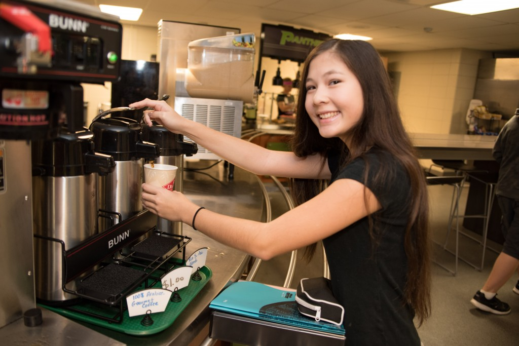 Ninth-grader Eden Gyen, gets a cup of coffee before her first class of the day.