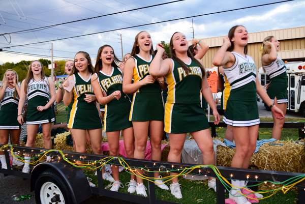 Pelham cheerleaders chant cheers while riding down Bearden Road during their Sept. 22 homecoming parade. (Reporter photo/Keith McCoy)
