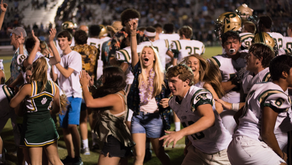 Pelham students and players celebrate on the field after upsetting Helena 27-23 on Friday, Sept. 9 at Husky Stadium. (Reporter Photo/Keith McCoy)