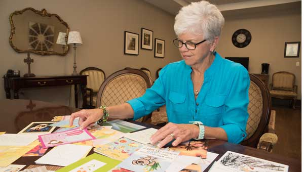 Shivers looks through her collection of more than 50 support cards that she received after her surgery from family and friends.