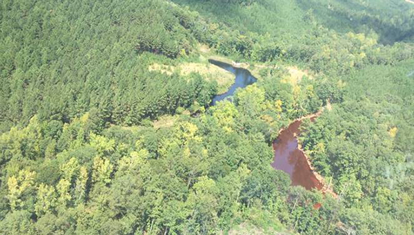 Pictured is an aerial photo of two of the three mine water retention ponds at the incident site in unincorporated Shelby County. The retention pond on the right is where the gasoline has been contained. (Contributed)