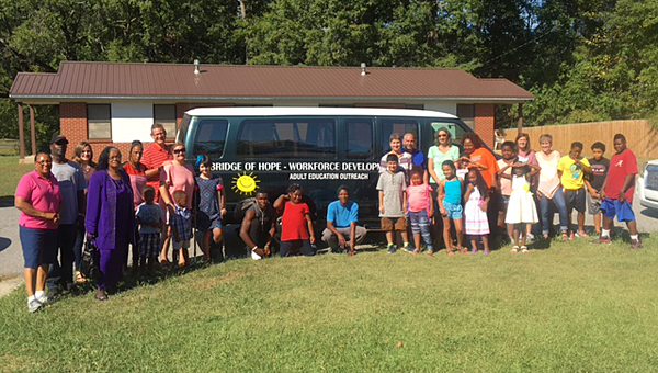 Kids First celebrates receiving a new van donated by First Baptist Church during a Sept. 25 family board game day hosted at Kids First by the church. (Contributed)