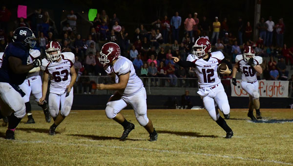 Chadwyn Russ (No. 12) calls a block on a run to the outside Friday night at Jemison.(Photo by Steven Calhoun)