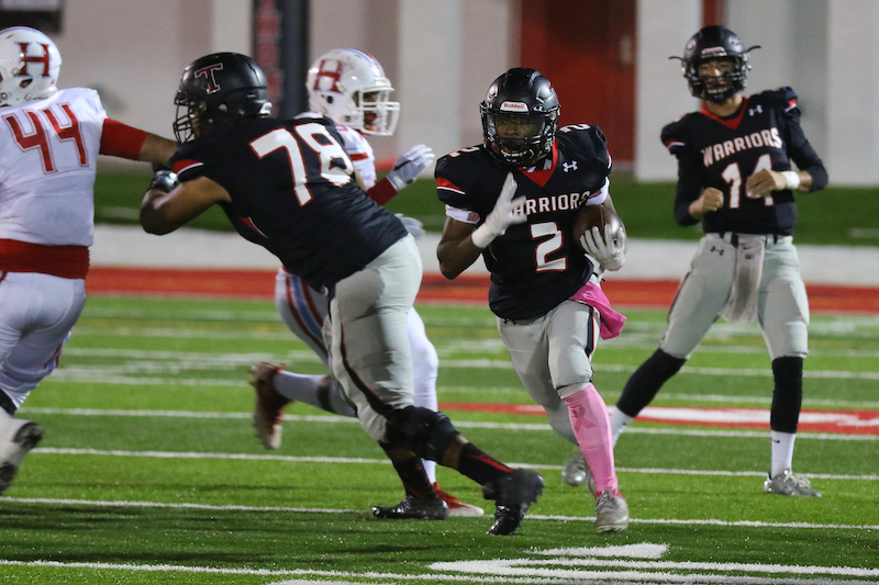 Corey Burroughs looks for room to run on Oct. 27 in Thompson's final regular season game of the year against Hillcrest-Tuscaloosa. (For the Reporter / Eric Starling)