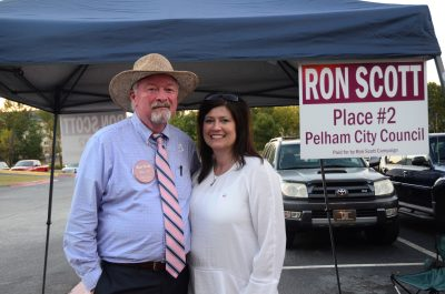 Ron Scott and his fiancé Sarah Walker stood outside of the Pelham Civic Complex talking to voters on the day of the runoff election, Tuesday, Oct. 4. (Reporter photo/Briana Harris)