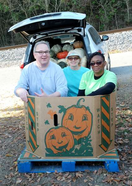 Chris Van Cleve, Brian Puckett, Gennetter Smith, Peggy Holly, Ana McDonald Baker of the Helena Beautification Board were on hand early on October 15 to create this photo backdrop display at The Caboose in Old Town. (Contributed)