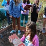 Hilltop Montessori School students unearth and make notes about an artifact they found as part of the Digscovery project facilitated by Jefferson State Community College and Phi Theta Kappa.