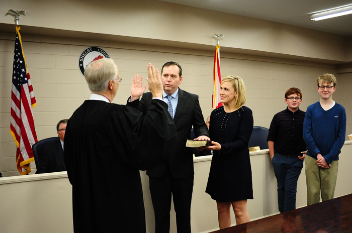 Ward Williams, the only new member of the Shelby County Commission, takes an oath of office administered by Probate Judge Jim Fuhrmeister while family members look on. (REPORTER PHOTO/STEPHEN DAWKINS)