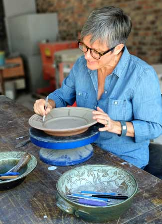 Robin is hard at work on one of her platters.