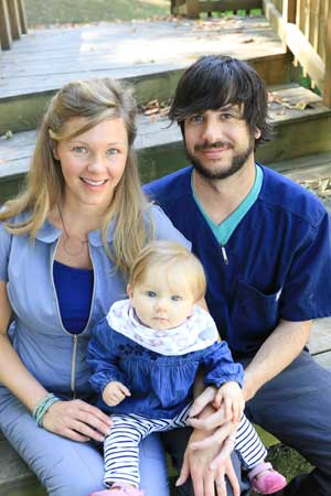 Dr. Natalie Lenoir-Blackman pauses for a photo with husband Beau and daughter, Hannah Grace.