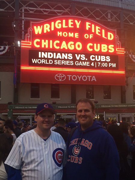 Mark (right) and Marty (left) Windham pose outside Wrigley Field before Game 4 of the 2016 World Series. Mark Windham won a baseball state championship in 2005 at Shelby Academy, and now coaches baseball at football at Calera Middle School. (Contributed)