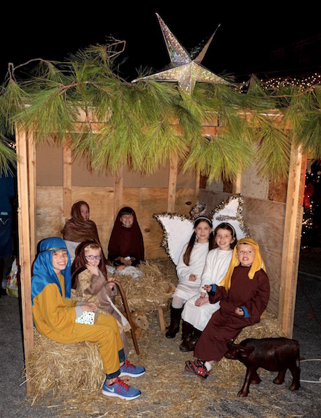 Here, the Wise Men and Shepherds are joined by Heavenly Host angels in the Manger Scene presented by Gospel Light Baptist Church at the December First Friday in Helena. (Contributed)