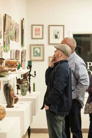 Residents browse artwork at the Shelby County Arts Council gallery in Columbiana.