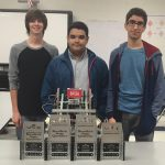 Oak Mountain High School students Adam Pendry (left) Hamid Choucha (center) and Omar Zuaiter (right) recently won the BrewTech State Qualifier Vex Robotic Competition. (CONTRIBUTED)