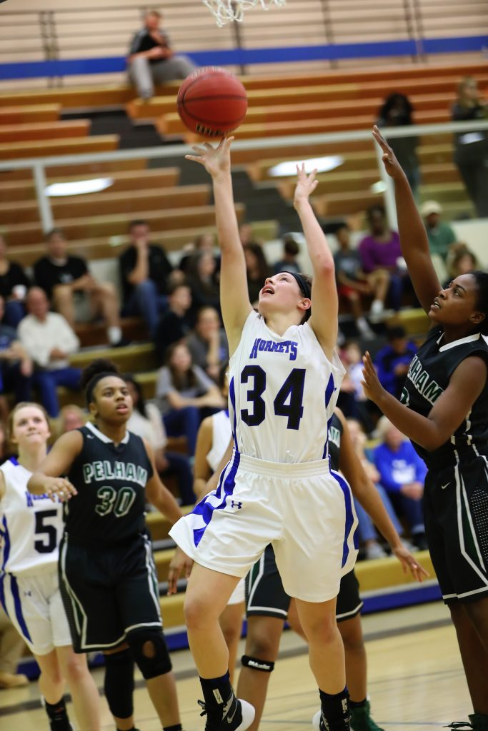 Michaella Edwards, No. 34, shoots a layup after getting past the Pelham defenders. She led all scorers with 36 points in the game. (For the Reporter/Cari Dean)
