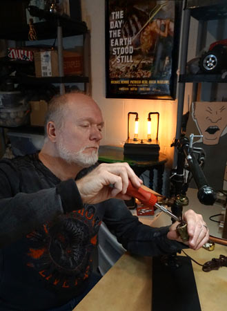 Craig Doriety works on one of his lamps.