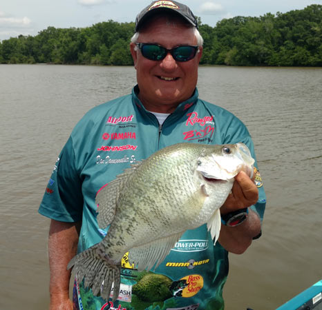 "Alabama resident and crappie tournament pro Dan Dannenmueller, who is also publisher of the popular online crappie magazine, ""Crappie Now,"" displays a catch."