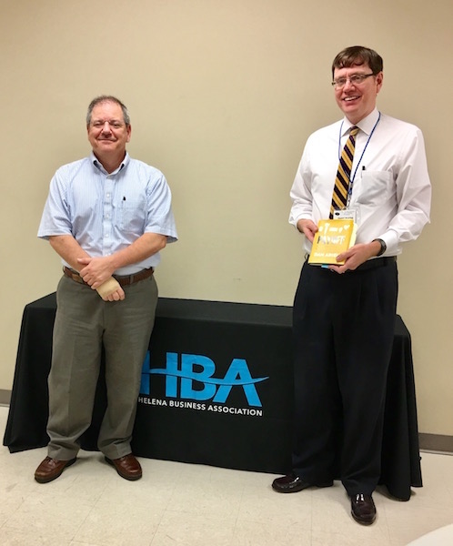Dan Dearing, right, shares with HBA members and Johnny Carcioppolo, left, a monthly book selection pertinent to business owners. (Contributed)