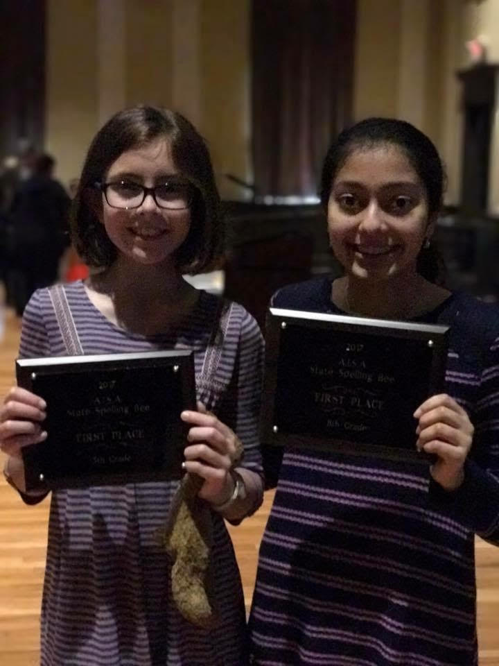 Two Kingwood Christian School students recently won awards at the Alabama Independent School Association state spelling bee. Hannah Fisher, left, and Nicki Modi, right, hold their awards after the state competition earlier this month. (Contributed photo.)