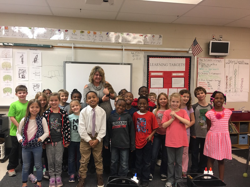 Tonya Brooks teaches second grade at Calera Elementary School Calera Elementary School where she has a class pet named Allie Bama. Brooks is pictured with her class, and the guinea pig. (Contributed photo.)