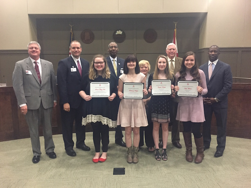 "Thompson High School's Theatre Department was recognized during a recent Alabaster Board of Education meeting for winning several awards and scholarships after competing in the 76th Walter Trumbauer State Theatre Competition in Florence. Pictured (left to right) are Sarah Avery Vises, who placed second for ""stage management novice,"" Brittany Hodge, who placed first for ""sound design varsity,"" Cecilia Koloski, who won a $1,000 scholarship for technical theatre and Hope Martin, who won a $1,000 scholarship for performance. (Photo by Emily Reed.)"